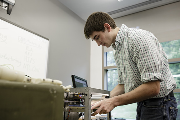 "Joseph Sinclair prepares a 3D-Printer in order to showcase a mobile training unit that will be used to teach students about 3D Printing in a Solid Dynamics ""Introdudatuion to 3D-Printing Course"" offered at Penn State Berks.   Image: Penn State"