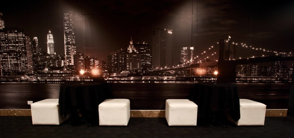 The Manhattan Lounge at GPO offers a floor to ceiling mural of the NYC skyline