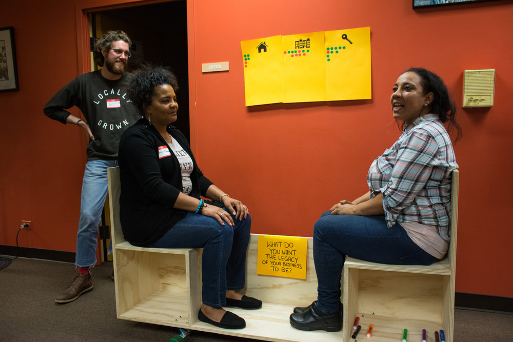 """Conversation Bench - This activity was designed by an Archeworks team to create a platform for intentional conversation. Two participants sat face-to-face and answered questions (drawn out of a hat) such as, """"What do you want the legacy of your business to be?"""""""