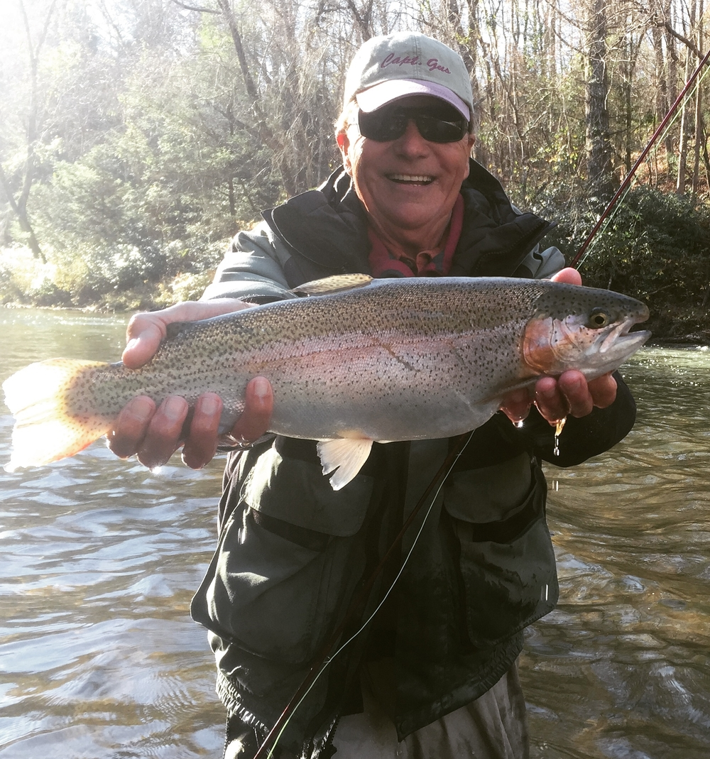 Client of BRCF customer Marc Thompson, owner of Halcyn Outfitters with a big Georgia rainbow caught on a Golden Ticket stonefly.