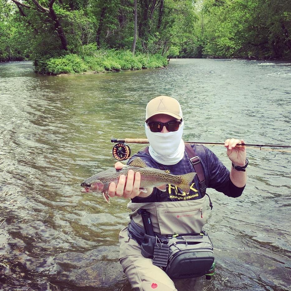 Mason Coffey showing off a Watauga tailwater rainbow caught on my black licorice stone.