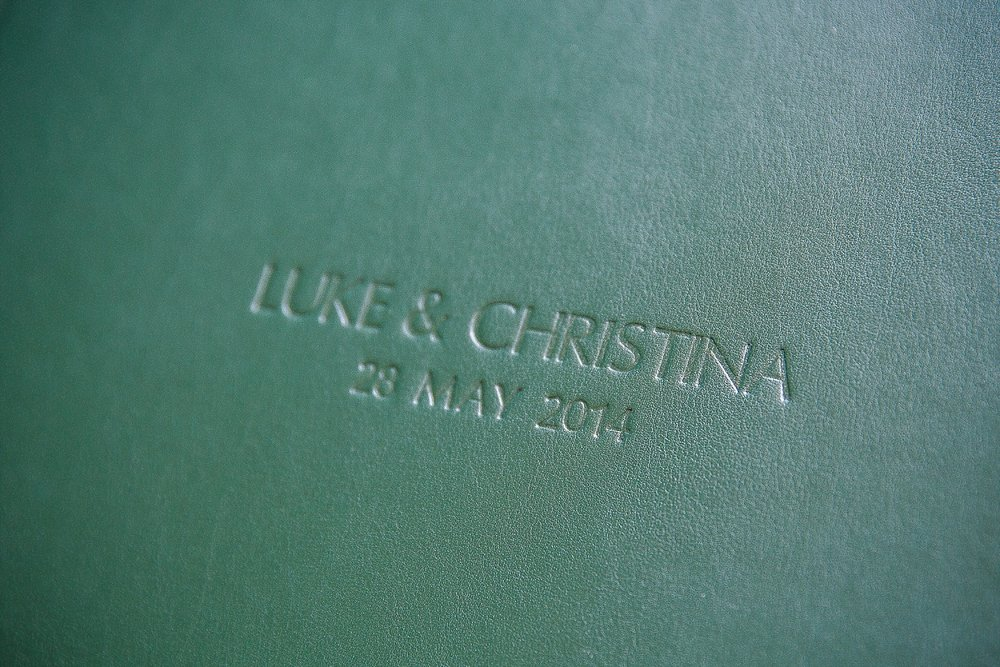 Bottle green leather album cover with blind embossing