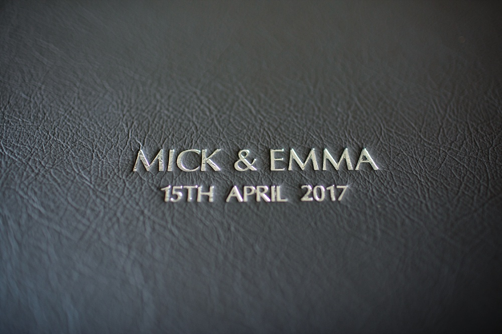 Black leather cover wedding album with silver embossing