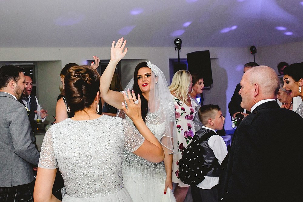 Houchins Essex Wedding Photographer - Bride on the dancefloor