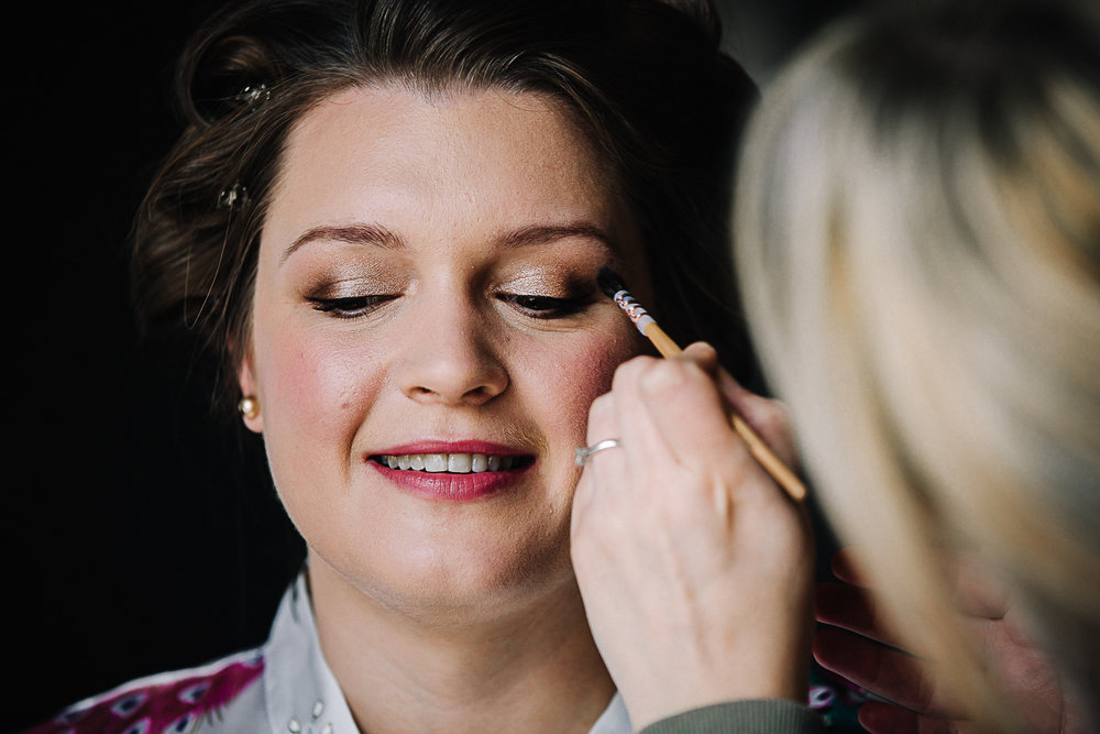 Bride getting her makeup applied - Swynford Manor Wedding Photographer