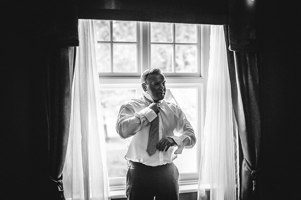 Bestman getting ready - Swynford Manor Wedding Photographer