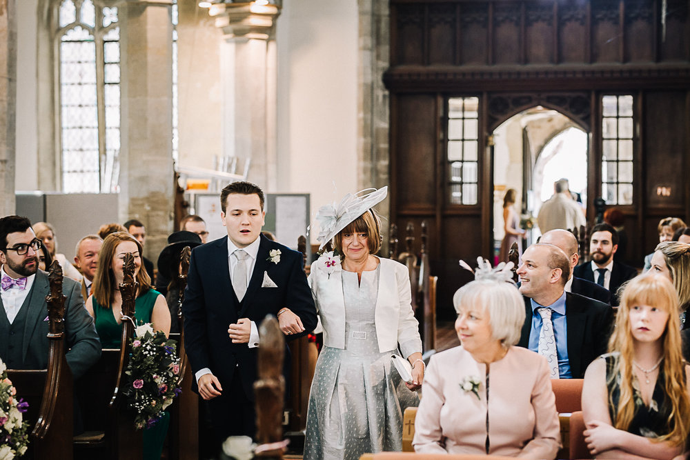 Mother of the Bride Walking Down the Aisle at Cottenham All Saint's Church - Swynford Manor Wedding Photographer