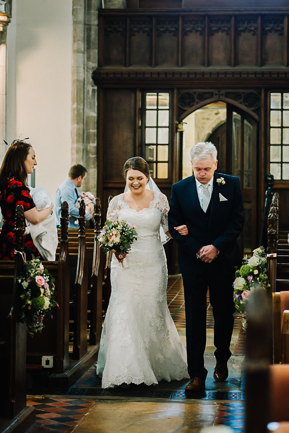 Bride Walking Down the Aisle at Cottenham All Saint's Church - Swynford Manor Wedding Photographer