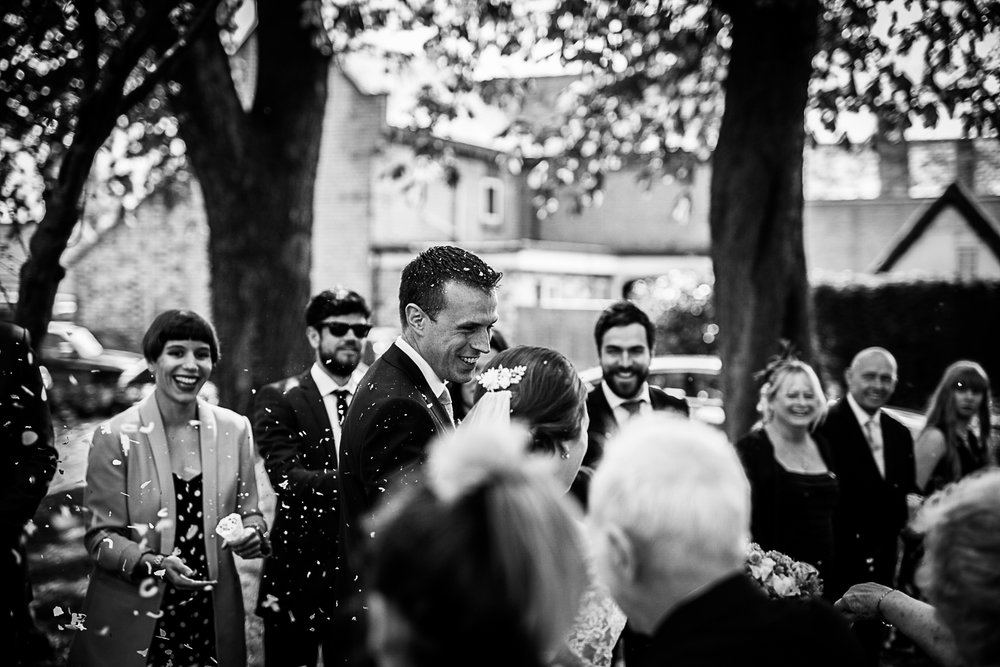 Confetti in the gardens at Cottenham All Saint's Church - Swynford Manor Wedding Photographer