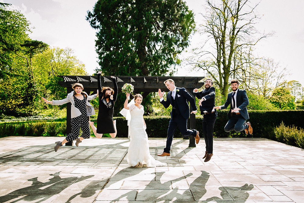 Guests Jumping Shot at Swynford Manor Wedding