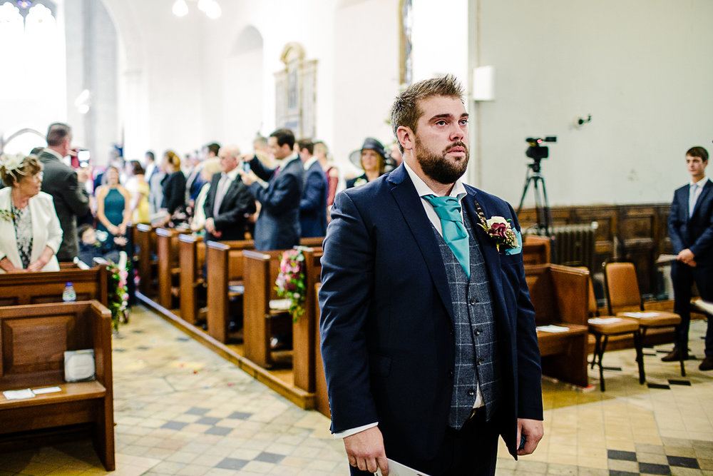 Tudor Barn Belstead Suffolk Wedding Photographer - Groom at the church altar