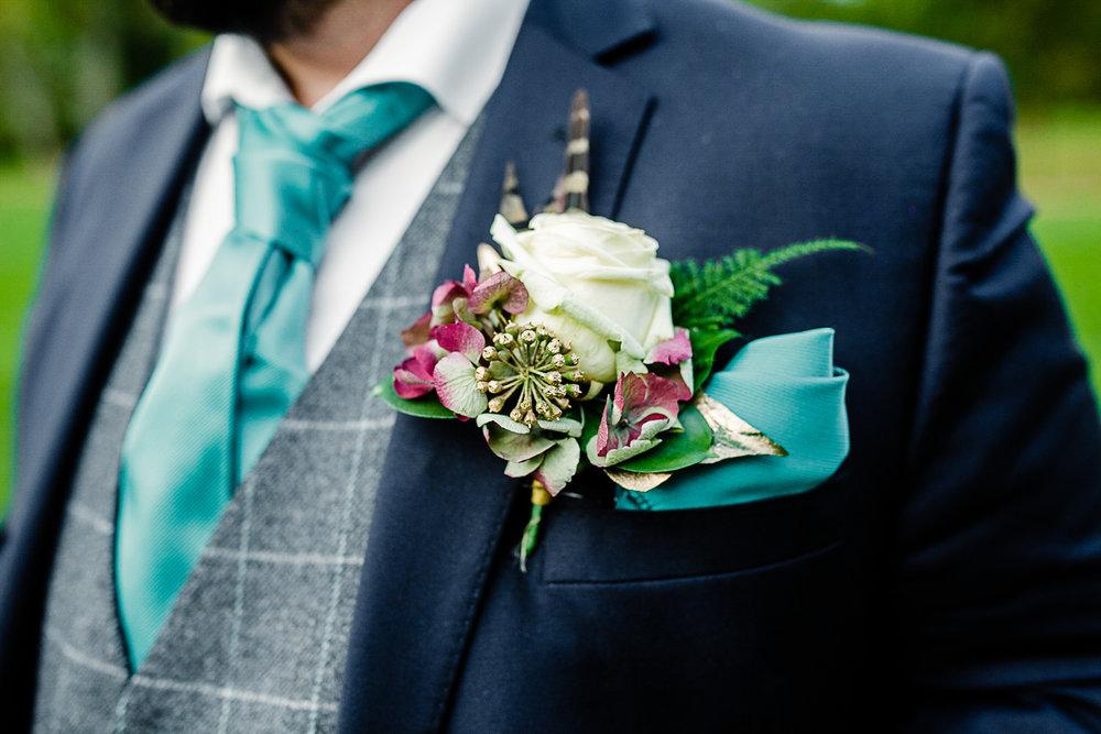 Tudor Barn Belstead Wedding Photographer - Groom's Button Hole