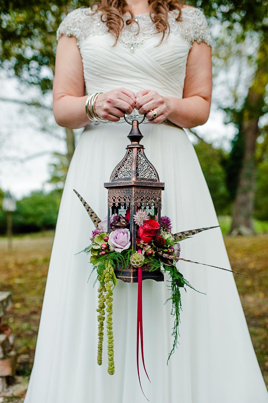 Tudor Barn Belstead Wedding Photographer - Bridal portrait in the gardens - Game of Thrones - Lantern Floral Arrangement