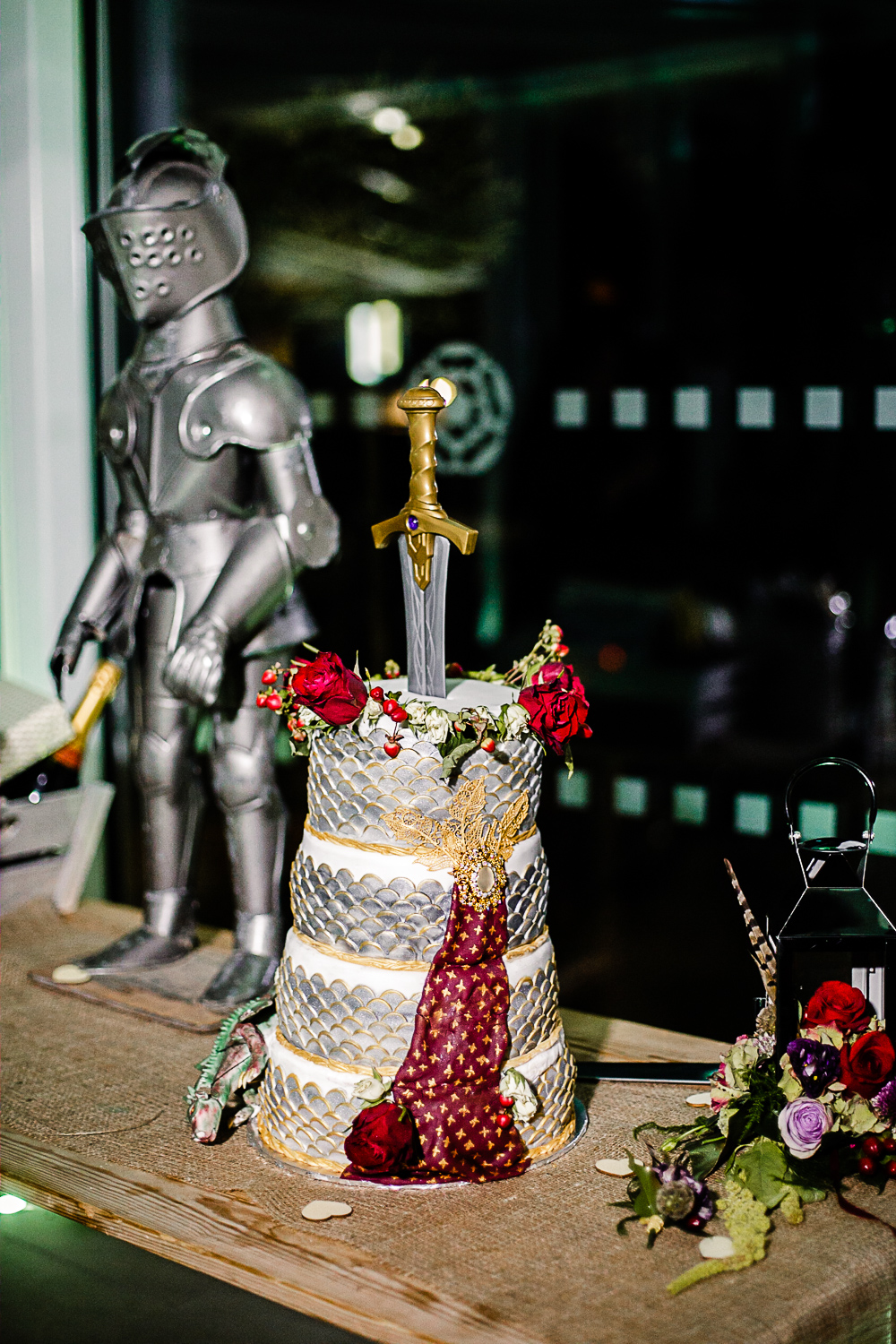 Tudor Barn Belstead Wedding Photographer - Cake cutting - Game of Thrones Theme