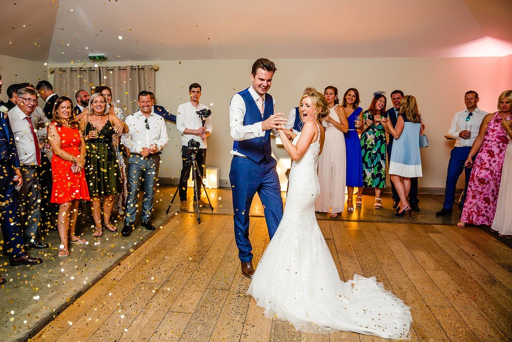 CONFETTI CANNONS DURING THE FIRST DANCE AT HOUCHINS ESSEX
