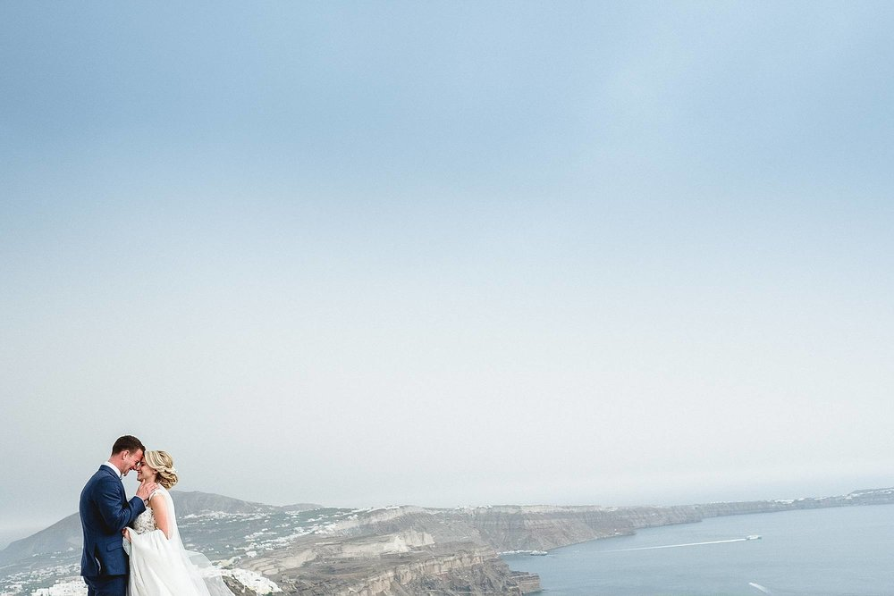 HANNAH & ELLIOTT'S DESTINATION WEDDING IN the scenic hills of SANTORINI greece