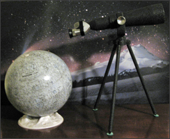United's 40mm spotting telescope is shown standing next to a 5-inch diameter Replogle moon globe.