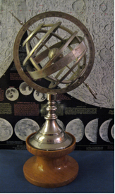 This simple armillary sphere (with a National Geographic Society moon map in the background) has a total height of 10½-inches and measures 6-inches across. It was found in a downtown Albany antique store for $30 (the wood base was not included).
