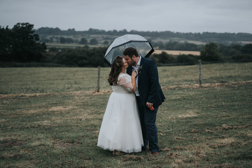 Romantic rainy smooch under an umbrella. And Tony brought his gin with him…what a lad!