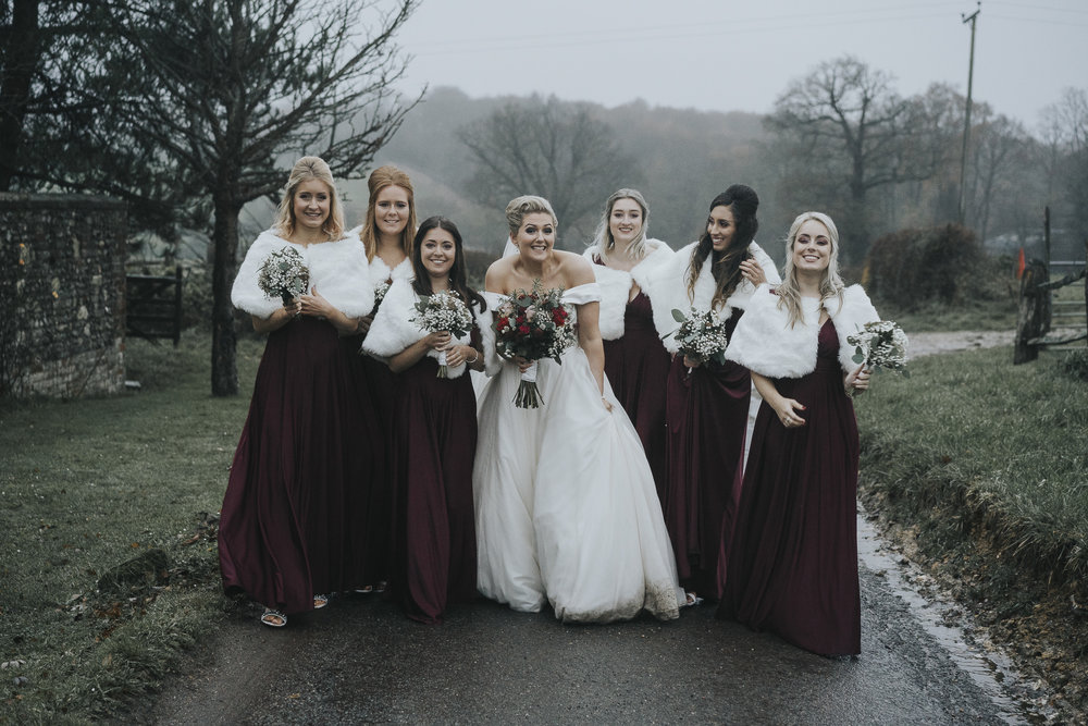 Alice + her maids were not afraid of a bit of rain!
