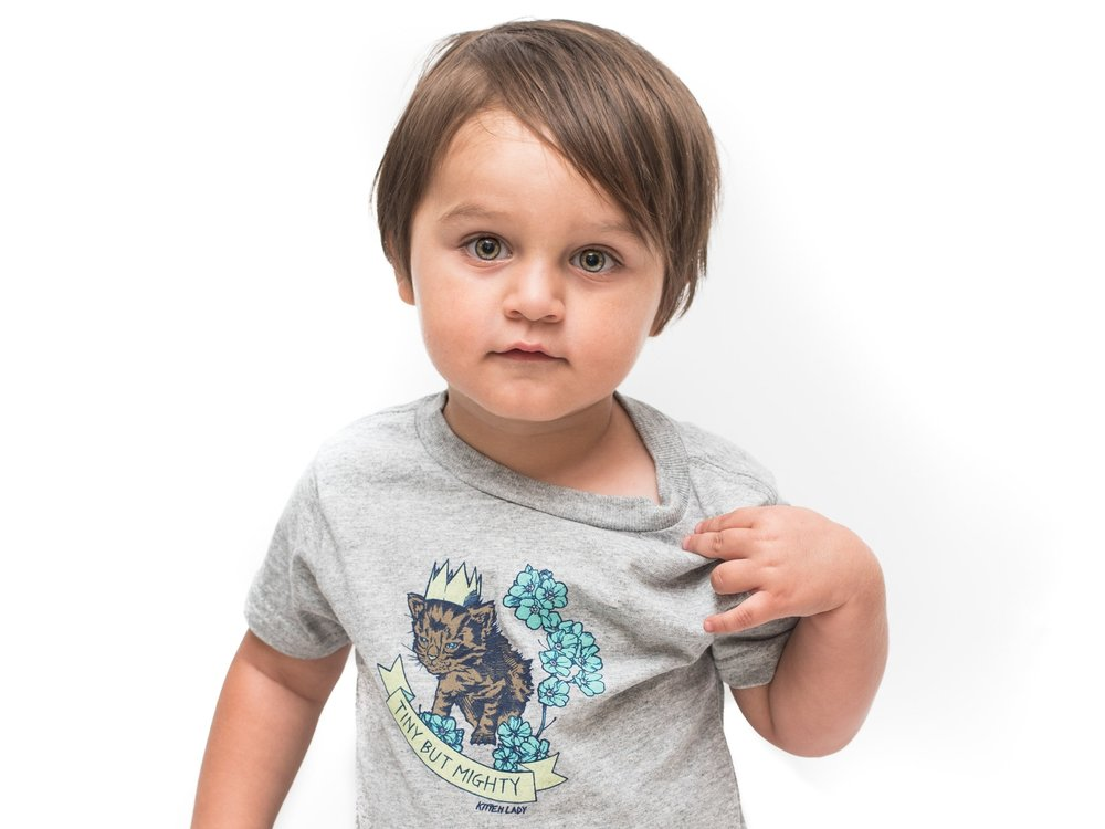"Click here to purchase Jelly's ""Tiny But Mighty"" tee and onesie for kids!"