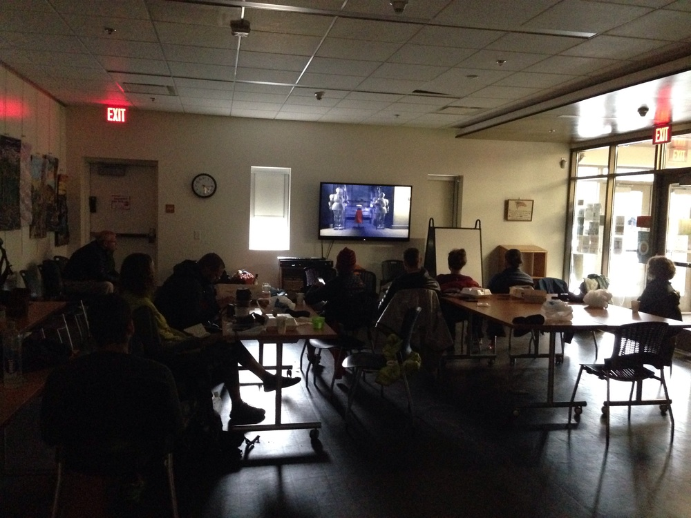 Hikers watching Shrek at the library.