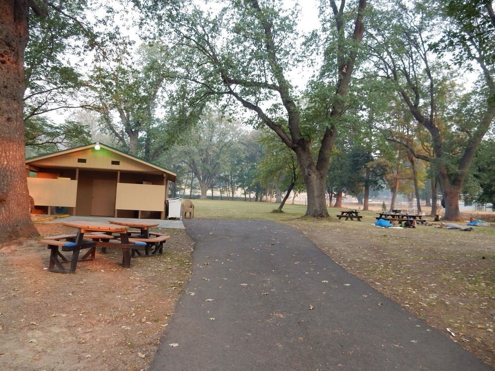 A bathroom, electrical outlets, and picnic tables. Hiker heaven.