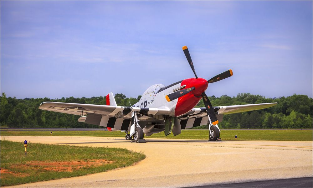P-51D owned by the Commemorative Air Force, and operated by the Dixie Wing in Peachtree City, Ga.  ©2013 John Slemp