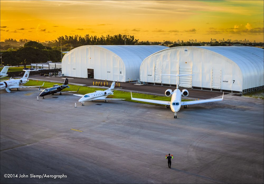 A lineman safely guides a departing Gulfstream jet at Opa-locka Executive Airport, near Miami.