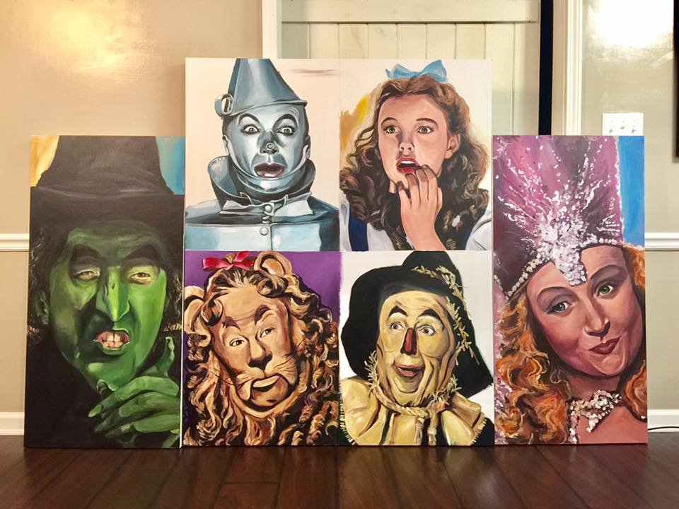 9/30/16 What an undertaking!!!! The 6 faces are completed and all that's left is to tie them together as 1 giant painting--and that's what the background is doing to do.  So...I thought about using different colors (to represent the rainbow) but now I'm leaning towards some yellow brick road imagery moving though the backgrounds. Otherwise--I LOVE LOVE LOVE this 8ft long 5 ft tall OZ painting!!! Who's your favorite??