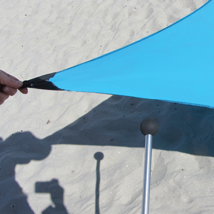 5. Prop up beach tent with poles