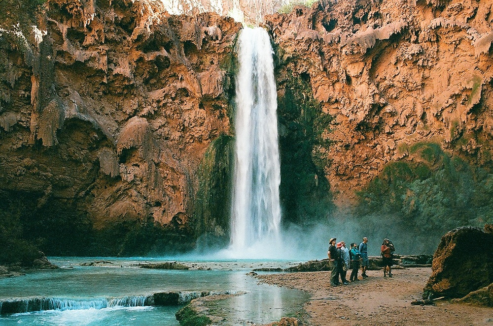 Getting to Mooney Falls is no joke. It's hard not to stare at the painstaking process of climbing down the slippery steps carved into the steep cliff.