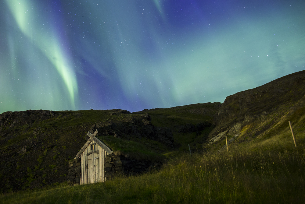 The Northern Lights from Gudrunarlaug, a legendary hot pool in west Iceland. // Nick Cote