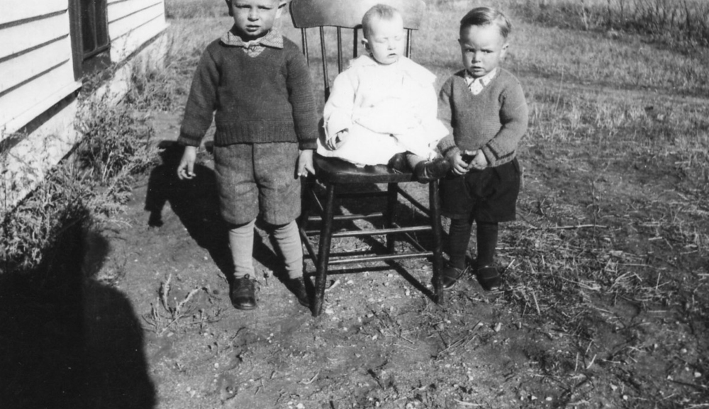 This is a photo taken by my grandfather in around 1941. My dad is the boy on the right. You can see my grandfather's shadow on the ground.