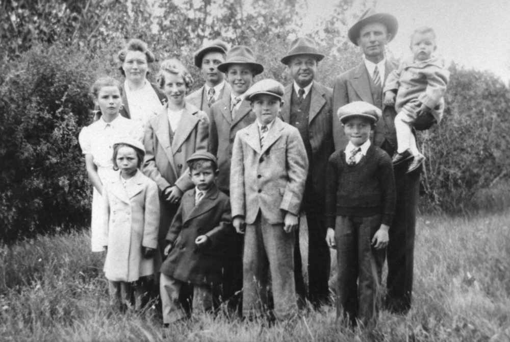 One of my grandfather's many family photos. My dad is to the right of the blond girl in the second row.