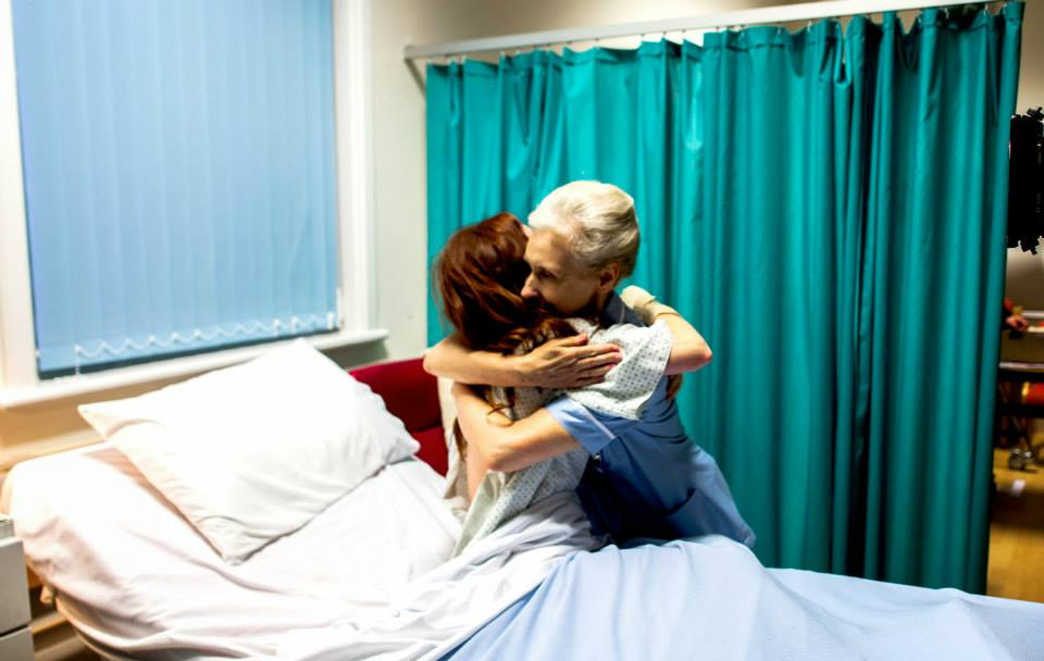Nurse Mary (Anita Dobson)comforts Nora (Katharine McEwan).