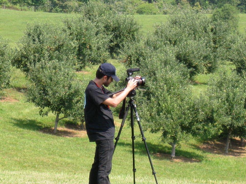 Director of photography Jon Silva sets up a shot.