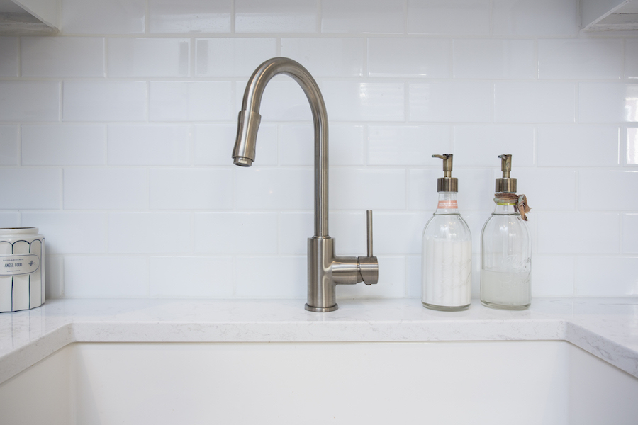 Kitchen sink with white subway tiles