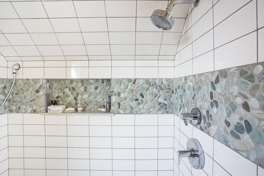 natural stone pebble mosaic strip in shower