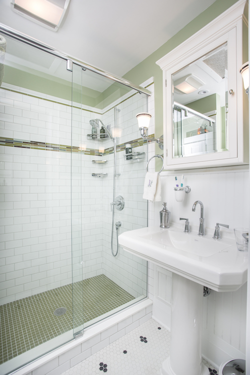 Green floor tile in shower