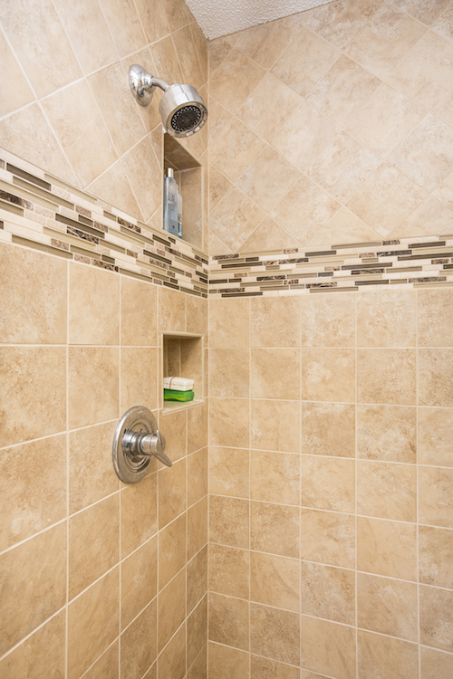 Tan shower tiles