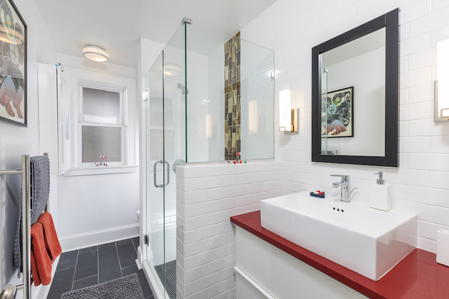 White bathroom with red countertop