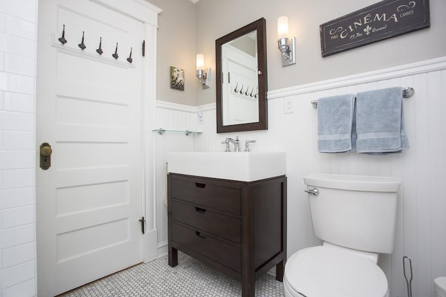 Minneapolis-St.Paul_Bathroom-Remodel_White-tile-chocolate-cabinets_Metamorphosis.jpg