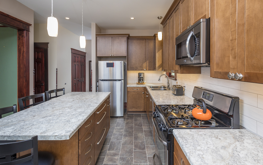 Minneapolis-St.Paul_Kitchen-Remodel_Grey-Countertop_brown-cabinets_Metamorphosis.jpg