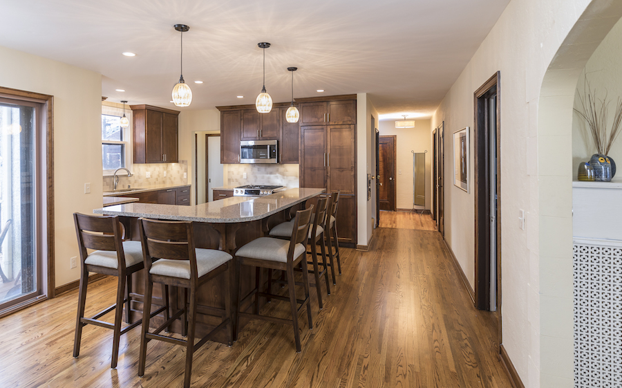 Kitchen with center island and walnut cabinets