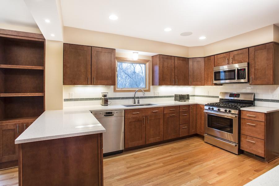 Minneapolis-St.Paul_Kitchen-Remodel_white-countertop_brown-cabinets_Metamorphosis.jpg