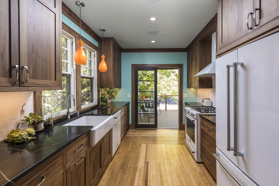 Green kitchen with walnut cabinets