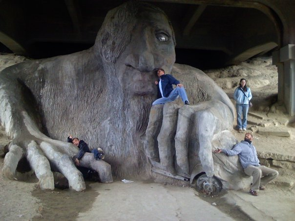 I was born in Seattle, which may very well be the quirkiest major city in America, if not the world. Seattle prides itself in being unique, and that attitude is pervasive throughout the city.     This is my favorite public sculpture - the Fremont Troll (from the Three Billy Goats Gruff fairytale). It is holding a Volkswagen Beetle which it swiped from the Aurora Bridge underneath which it hides. The car has a California license plate which is just one more reason it is so beloved by Seattlelites.   Click here for the history of the Fremont Troll  .