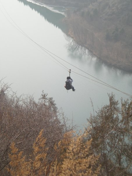 I've ziplined off the Great Wall of China. It was a VERY rickety contraption, and probably not something I would do in my older age.