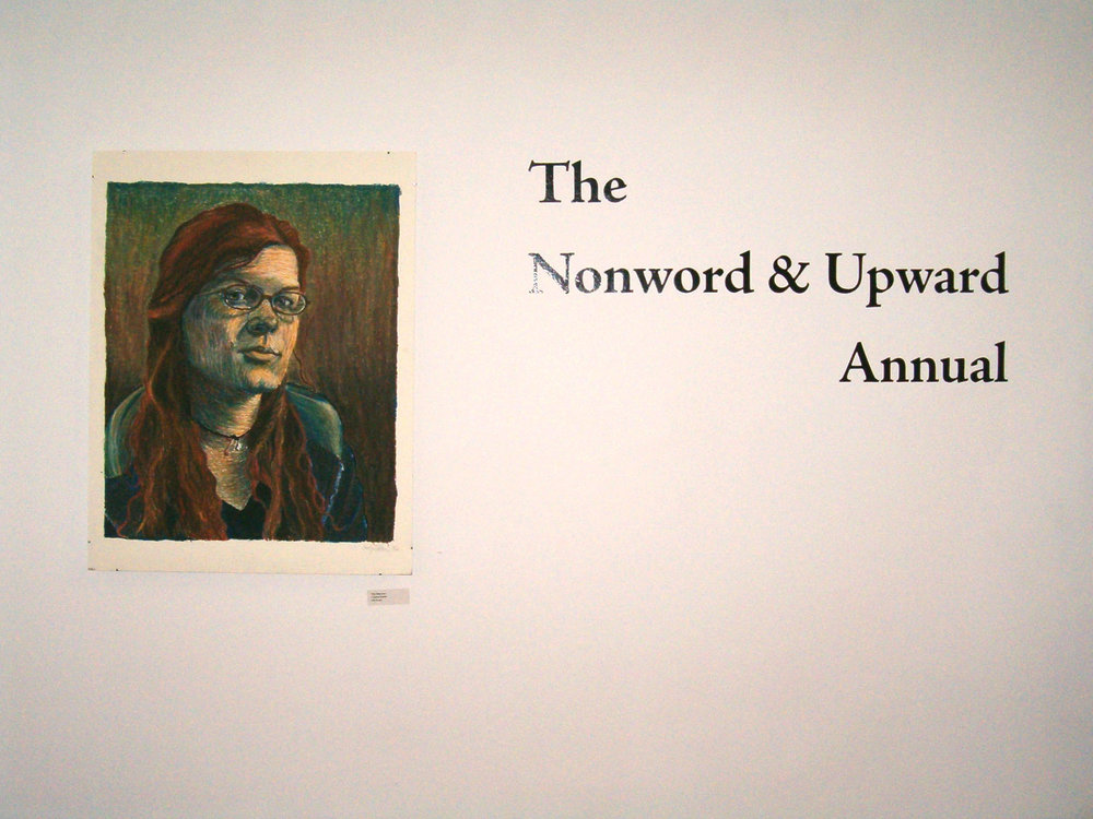 Self-portrait  Oil pastel on board.